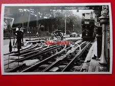 PHOTO  LONDON TRANSPORT TRAM NO 452 - GOING OVER TRACK BEING REPAIRED