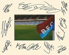 A 10 x 8 inch mount personally signed by 12 Burnley players on 25.07.2016. (2).
