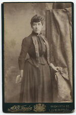 CABINET CARD WOMAN STANDING WITH BOOK AND FLOWER IN HAND. LIVERPOOL.