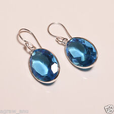 Swiss blue topaz faceted stone oval shaped elegant earring pair .925 silver