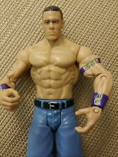 2011 Mattel WWE John Cena action figure with purple bands and light blue shorts