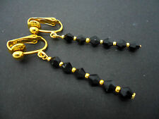 A PAIR OF BLACK CRYSTAL GLASS BEAD  GOLD PLATED CLIP ON DROP EARRINGS. NEW.