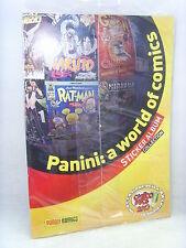 Album figurine-PANINI:A WORLD OF COMICS -omaggio CARTOOMICS 2013-VUOTO SIGILLATO