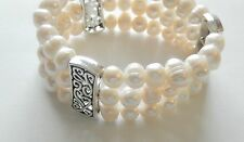 Bracelet-Freshwater Pearls-3 strands-stretchy-white pearls-silver color spacers