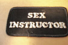 "SEX INSTRUCTOR BLACK W/WHITE LETTERS, NEW 4"" X 2"" CLOTHING PATCH"