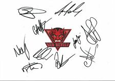 12 x 8 inch photo featuring the Salford Red Devils badge personally signed by 10