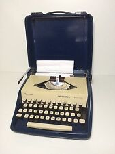 Remington Envoy III portable typewriter : Sperry Rand : blue : cased : 1960s