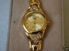 Nice New Q&Q by Citizen Gold Tone Lady Dress Watch w/Diamond Bezle