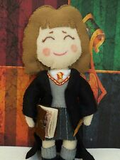 Hermoine Granger art doll with wand and spell book from Harry Potter