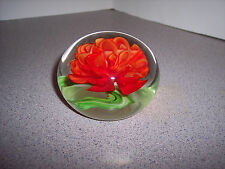 UNMARKED RED ORANGE HAWAII FLOWER SOLID GLASS PAPERWEIGHT