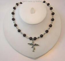 Hand crafted Dragon necklace with blood red Garnet gemstones and celtic beads