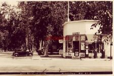 POST OFFICE and STORE WINNEBAGO, WI RPPC C-2 man standing by 40's era auto