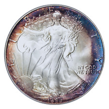 1986 $1 Silver Eagle PCGS MS69 ( Nicely Toned ) ASE Made in the USA Eagle Label.