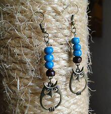 Boucle d'oreille hibou bronze et perles de bois. Bijou fait main