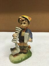 Plastic Hummel Look Alike Newspaper Boy Figurine