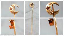Épingle à cravate décors lune ou croissant serties pierre-perles,or 18K aigle.