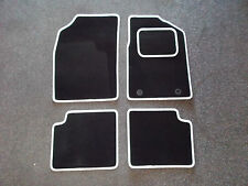 Ford KA (09-12) Black Carpet With White Leather Look Trim Car Floor Mats Set