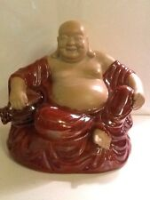 """Seated Happy Buddha Ceramic With Brown Robe And Jug 9 1/2"""" H X 9 1/2"""" W"""