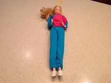Vintage Barbie Blond Hair Blue Eyes Turns At Waist With Outfit shown.