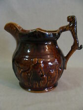 Arthur Wood Ceramic  Brown Pitcher Embossed Scene Of Lions With Man. Lion Handle