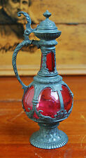 A Victorian cranberry glass, pewter church, gothic, baroque altar jug