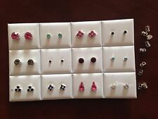JOB LOT-12 pairs of different styles coloured diamonte stud earrings.Silver pl.