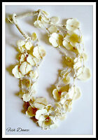 MULTI STRAND IVORY COLOURED SHELL STATEMENT NECKLACE. GREAT GIFT IDEA!!!