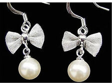 Pretty silver tone mesh bow with hanging pearl earrings
