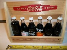 COCA COLA RARE SET OF MINI BOTTLES EVOLUTION 1899 - 1923 WITH MINT STAND