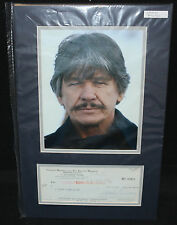 Charles Bronson Photo Matted with Signed Check - PSA DNA Authentic - 1974