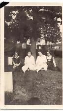 Young Edwardian Fashion Women Sitting Under Tree In Cemetery By Tombstone Photo