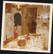 Old Vintage Photograph Little Girl Sitting By Refrigerator in Retro Kitchen