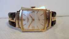 vintage Man's Longines wristwatch thick hourglass shape excellent working cond.