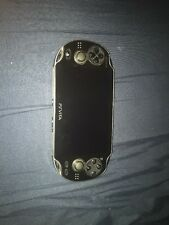 Sony Ps Vita With 8gb Memory Card And 4 Games