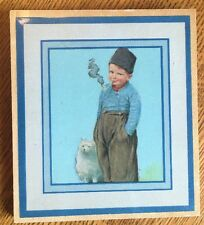 1940s Small Wood Picture of Young Dutch Boy Smoking a Pipe, White Spitz Dog