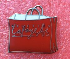 Pins ARTHUS BERTRAND SAC ROUGE GALERIES LAFAYETTE PARIS