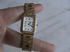 gold tone peugeot lady's quartz wrist watch