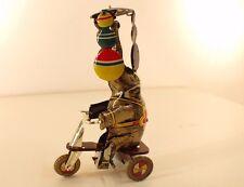 èléphant sur tricycle en tôle moteur à clé hauteur de 15 cm clockwork
