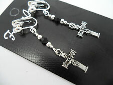 A PAIR OF  TIBETAN SILVER DANGLY FLOWER CROSS  & BLACK CRYSTAL CLIP ON EARRINGS.