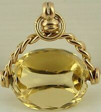 Small antique 9ct yellow gold swivel watch fob with faceted citrine, cairngorm