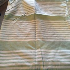 Green and white striped pillow case