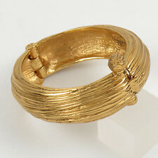 Yves Saint Laurent YSL Paris signed Clamper Bracelet vintage carved gold tone