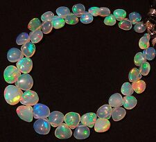Super Flashing & Playing Fire Ethiopian Opal 6-9MM Heart Briolettes 35Cts. 7""