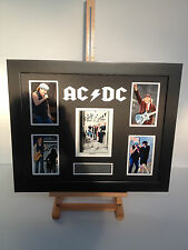 UNIQUE PROFESSIONALLY FRAMED, SIGNED ACDC PHOTO COLLAGE WITH PLAQUE.