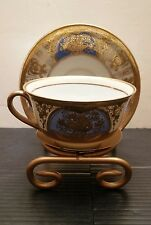 NORITAKE CUP AND SAUCER WITH DISPLAY RACK  ROBIN'S BLUE AND GOLD TYPE