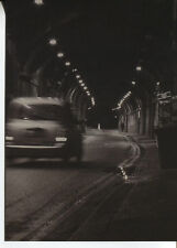 POST CARD OF A BLACK & WHITE PICTURE OF A CAR DRIVING AT NIGHT IN TIMELAPSE