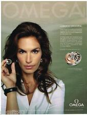 PUBLICITE ADVERTISING 105  2009  OMEGA   montre  co-axial  avec CINDY CRAWFORD