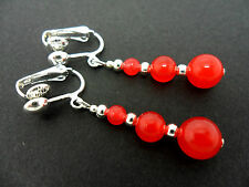 A PAIR OF DANGLY RED JADE SILVER PLATED CLIP ON   EARRINGS.