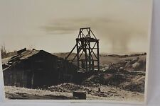 Great Professional Photo of GOLD MINE HEAD FRAME and cloud burst IN NEVADA