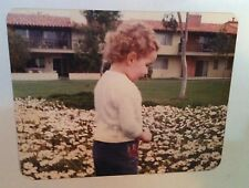 Vintage 70s PHOTO LITTLE GIRL IN CURLY HAIR PICKING FLOWERS AT ECONOMY MOTEL